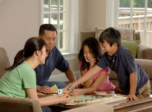 Family_playing_a_board_game_(3)
